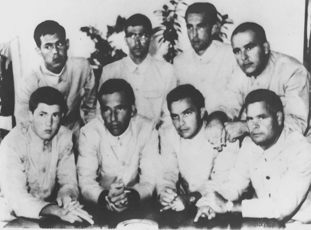 "The captured crew of the USS Pueblo giving the ""Hawaiian symbol for good luck,"" 1968"