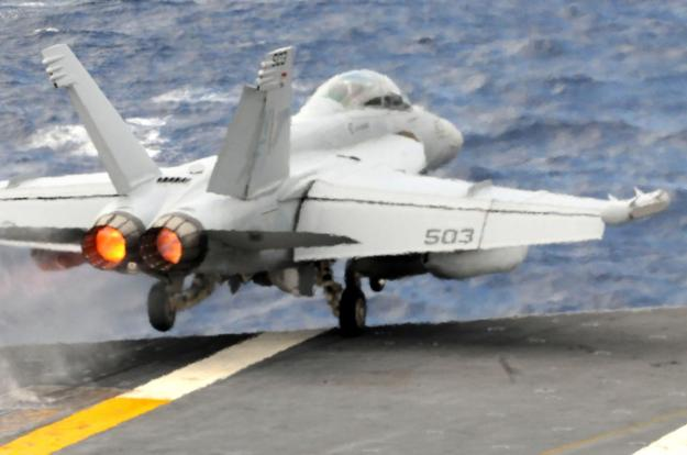 (June 3, 2012) An EA-18G Growler from the Shadowhawks of Electronic Attack Squadron (VAQ) 141 launches off the flight deck of the Navy's forward-deployed aircraft carrier USS George Washington (CVN 73). Growlers would be an essieintal component of a Syrian air intervention.U.S. Navy Photo.