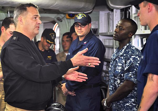 Vice Adm. Tom Copeman, commander of Naval Surface Forces, and commander, Naval Surface Forces, U.S. Pacific Fleet, meets Sailors aboard the Hawaii-based guided-missile cruiser USS Port Royal (CG 73) during a tour of the ship in November. U.S. Navy Photo