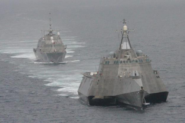 The first of class littoral combat ships USS Freedom (LCS 1), rear, and USS Independence (LCS 2) maneuver together during an exercise off the coast of Southern California on May, 2 2012. US Navy Photo.
