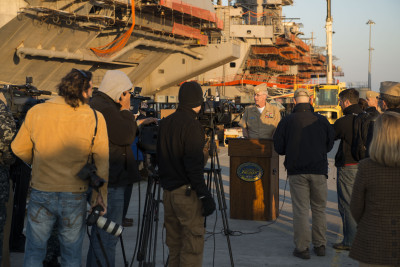 Rear Adm. Kevin Sweeney, commander of the Harry S. Truman Strike Group, addresses the media on the pier alongside the aircraft carrier USS Harry S. Truman (CVN 75) on Wednesday. US Navy Photo