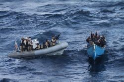 A US Navy visit, board, search and seizure (VBSS) team, approached a suspected pirate after the Motor Vessel Nordic Apollo reported being under attack and fired upon by pirates in 2011. US Navy Photo