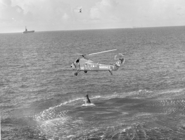 A Marine helicopter lifts Liberty Bell 7 after recovering astronaut Gus Grissom, July 21, 1961. The helicopter was forced to release the capsule and allow it to sink after it became flooded with seawater. Liberty Bell 7 was recovered from the ocean floor in 1999. US Naval Institute Archives