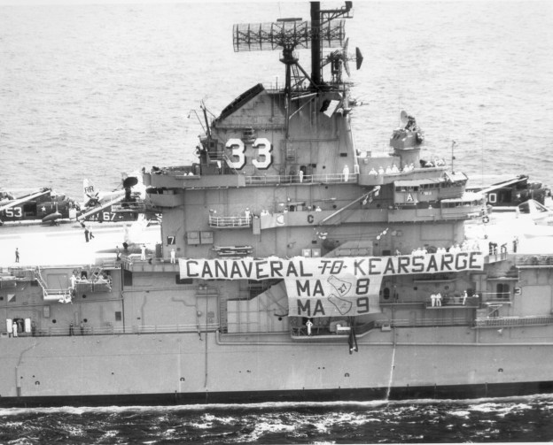The USS Kearsarge celebrates its role in astronaut recovery with a banner, May 18, 1963. US Naval Institute Archives
