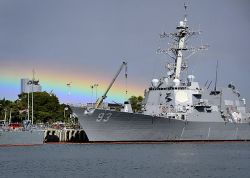 Arleigh-burke class guided missile destroyer USS Chung-Hoon (DDg 93) is docked at Joint Base Pearl Harbor-Hickam in May. The ship's deployment is delayed due to budget cuts. US Navy Photo