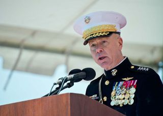 Commandant of the Marine Corps Gen. James Amos addresses the Sailors and Marines assigned to the newly commissioned amphibious transport dock ship USS Arlington (LPD-24) on April, 6 2013. US Navy Photo