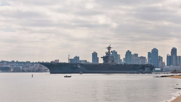 USS Carl Vinson (CVN 70) pulls out of Naval Air Station North Island, Calif. on June, 4 2013. US Navy Photo