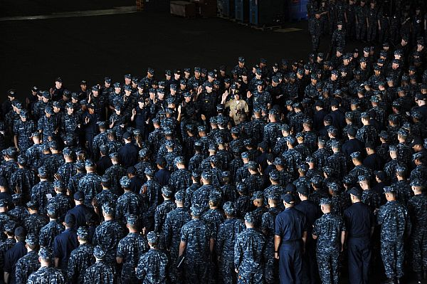ailors assigned to the aircraft carrier USS Dwight D. Eisenhower (CVN-69) read the reenlistment oath on Aug. 9, 2013. US Navy Photo