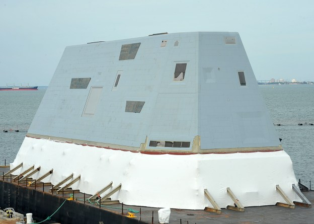 The deckhouse for the future USS Zumwalt (DDG-1000) sits on a barge at Norfolk Naval Station in 2012. US Navy Photo