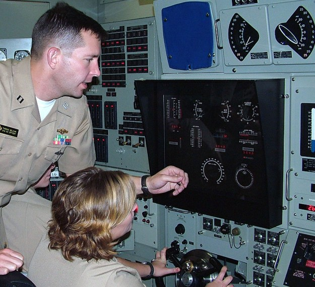 Lt. Thomas Belchik trains Midshipman 1st Class Elizabeth Byers in 2009. US Navy Photo