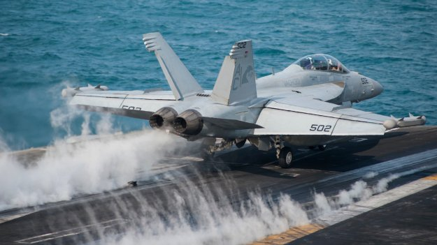 "An EA-18G Growler, assigned to the ""Zappers"" of Electronic Attack Squadron 130, launches from the flight deck of the aircraft carrier USS Harry S. Truman (CVN-75) on Jan 13, 2014. US Navy Photo"