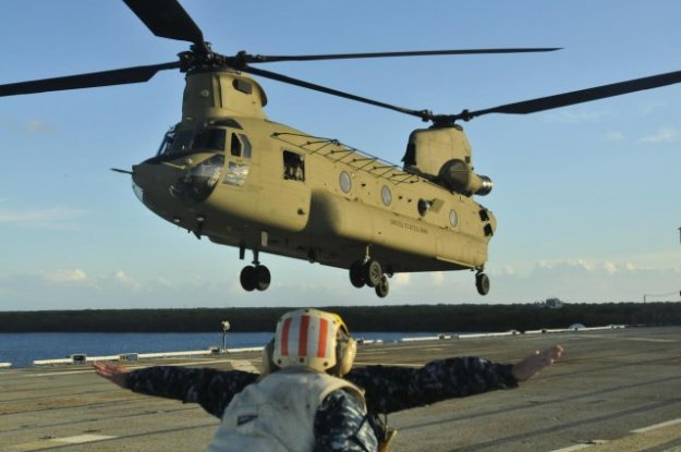 A US Army CH-47 Chinook lands on the USS Tarawa (LHA-1) during deck qualification in the Pacific Ocean, July 19, 2013. US Army Photo