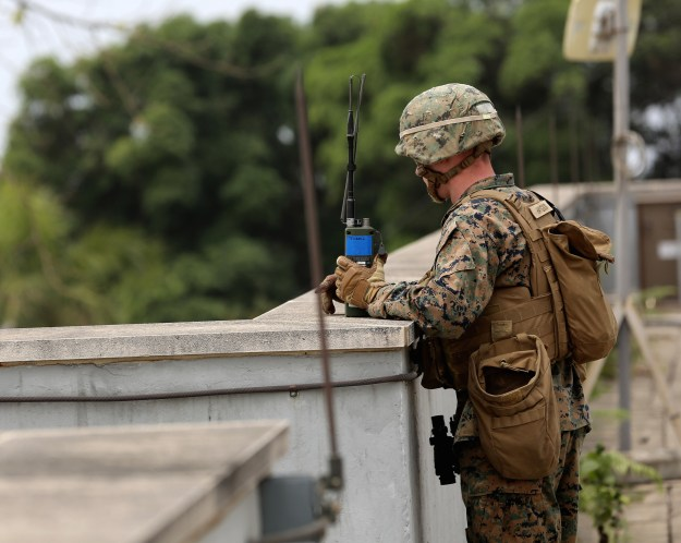A Marine provides an over watch for Marines conducting vehicle inspections at the American Embassy in Monrovia, Liberia, during a training exercise March 7, 2014. US Marine Corps Photo