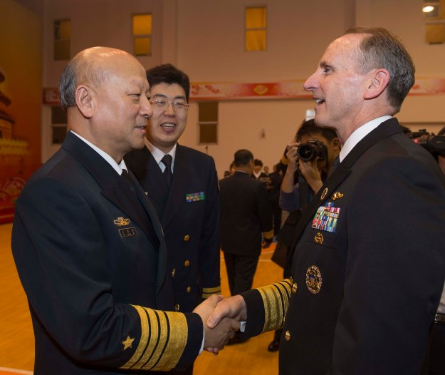 Chief of Naval Operations (CNO) Adm. Jonathan Greenert and Chief of Navy of the People's Liberation Army Navy (PLAN) Adm. Wu Shengli greet each other in Qingdao, China on April 21, 2014. US Navy Photo