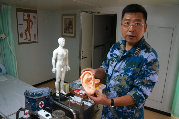 Capt. Tao displaying a plastic model of an ear during a tour of Peace Ark. Kyle Mizokami Photo