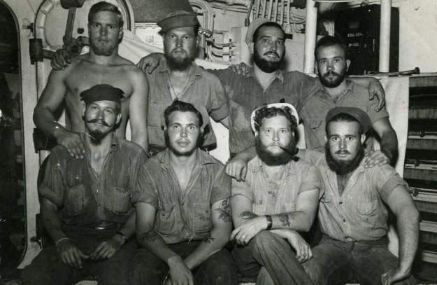 USS Pensacola proudly display their facial hair circa 1944