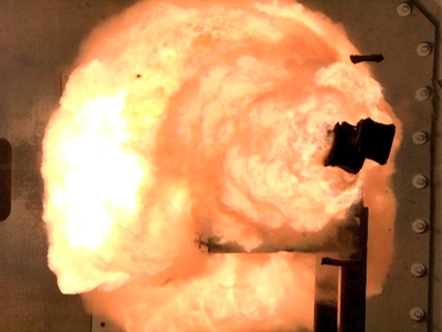 A high-speed camera captures the first full-energy shots from the Office of Naval Research-funded electromagnetic railgun prototype launcher in 2012. US Navy Photo