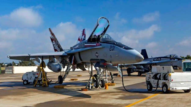An F/A-18 Hornet with Marine Fighter Attack Squadron 115 awaits maintenance during Exercise Max Thunder 14-2, aboard Kunsan Air Base, Republic Of Korea, Nov. 14, 2014. US Marine Corps photo.