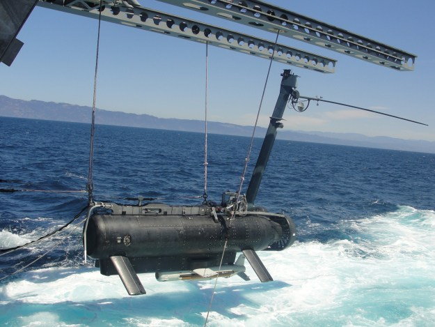The littoral combat ship USS Independence (LCS-2) deploys a remote multi-mission vehicle (RMMV) while testing the ship's mine countermeasures mission package (MCM) off the southern California coast in August 2013. Austal USA photo.