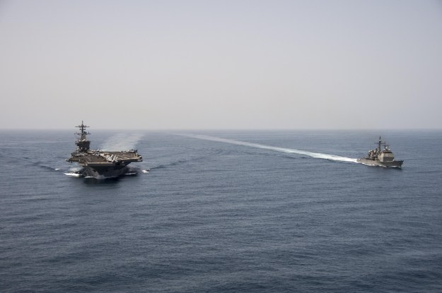 USS Theodore Roosevelt (CVN 71) and the guided-missile cruiser USS Normandy (CG 60) operate in the Arabian Sea on April 21, 2015. US Navy Photo
