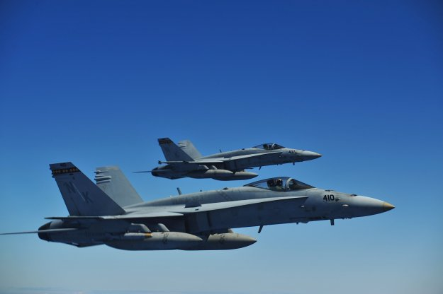 Two Marine Corps F/A-18C Hornets assigned to Marine Fighter Attack Squadron (VMFA) 323 fly a mission during Rim of the Pacific (RIMPAC) 2010. Two planes from the same squadron made an emergency landing in Taiwan on Wednesday. US Navy Photo
