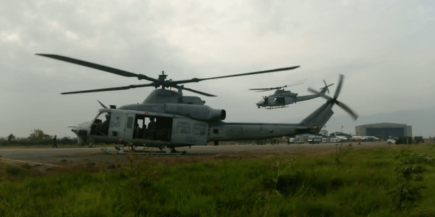 Two UH-1Y helicopters with Marine Light Attack Helicopter Squadron (HMLA) 469, take off from the Tribhuvan International Airport in Kathmandu, Nepal, May 13, 2015. US Marine Corp Image
