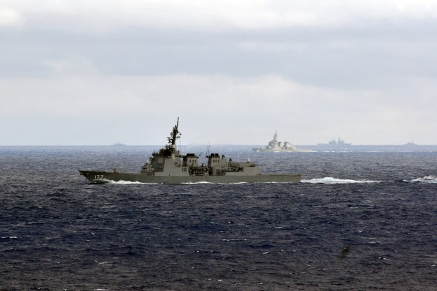The Japan Maritime Self-Defense Force (JMSDF) guided-missile defense destroyer JDS Atago (DDG-177) maneuvers with other JMDSF and U.S. Navy ships belonging to the USS George Washington carrier strike group in 2011. US Navy Photo
