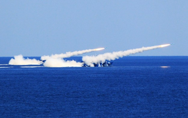 Chinese Type 022 Houbei-class Fast Attack Missile Craft firing missiles. People's Liberation Army Navy Photo