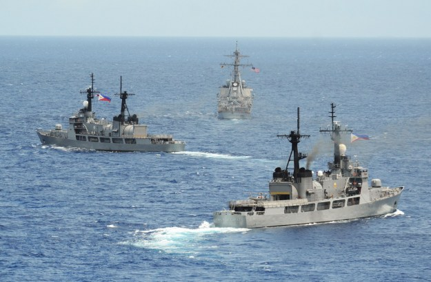 The Philippine navy frigates BRP Gregaorio del Pilar (PF-15), left, and BRP Ramon Alcaraz (PF-16), left, are underway with the Arleigh Burke-class destroyer USS John S. McCain (DDG-56) in 2014. US Navy Photo