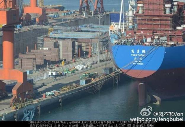 An April image of a ship that is almost certainly China's first domestic aircraft carrier at the Dalian shipyard in northern China obtained on the Chinese language Internet.