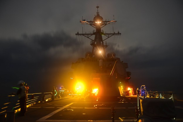 Sailors aboard the Arleigh Burke-class guided-missile destroyer USS Lassen (DDG-82) conduct a man-overboard drill on Sept. 28, 2015 in the South China Sea. US Navy Photo