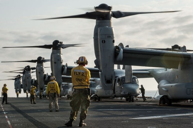 Sailors and Marines prepare to launch MV-22 Osprey tiltrotor aircraft from the flight deck of the amphibious assault ship USS Bonhomme Richard (LHD 6) in the South China Sea on March 19, 2015. US Navy photo.