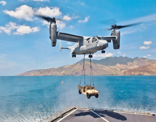 An MV-22B Osprey lifts a HUMVEE from the USNS Sacagawea April 11 at Subic Bay, Republic of the Philippines, during exercise Freedom Banner 2013. US Marine Corps Photo