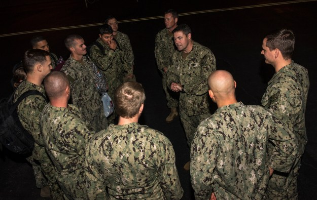 Capt. Gary Leigh, center right, commander, Coastal Riverine Group One, greets the 10 U.S. Navy Sailors assigned to Coastal Riverine Squadron Three, upon their return to Naval Air Station North Island on Jan. 22, 2016. US Navy Photo