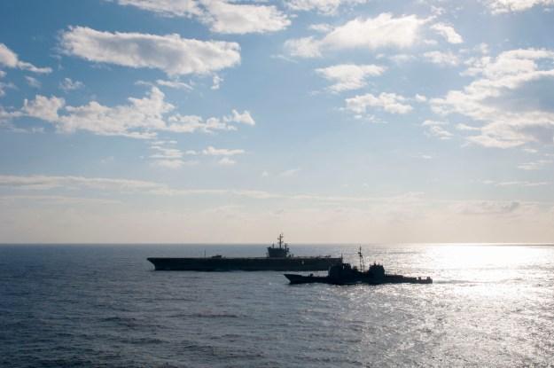 The Ticonderoga-class guided-missile cruiser USS Antietam (CG 54), right, steams alongside USS Ronald Reagan (CVN 76) in November 2015. US Navy photo.
