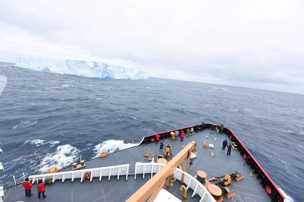 Passengers and the crew of CGC Polar Star gather to observe their first encounter with ice during Operation Deep Freeze 2016 in the Southern Ocean Jan. 3, 2016. The mission to resupply the National Science Foundation's McMurdo Station, Antarctica, is one of the most difficult U.S. military peacetime missions due to the harsh environment. US Coast Guard photo.