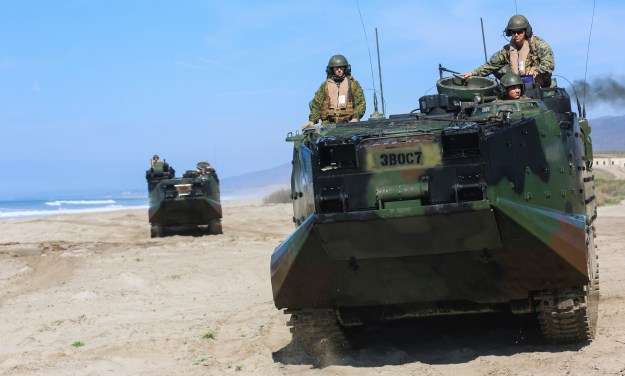 Marines with 3d Assault Amphibian Battalion, 1st Marine Division, 1st Marine Division, I Marine Expeditionary Force position amphibious assault vehicles for security during the amphibious landing exercise (PHIBLEX) for Exercise Iron Fist 2016. US Marine Corps Photo