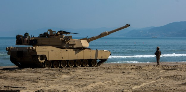 Cpl. Henry Estrada a gunner with 1st Tank Battalion from Lewisville, Texas, guides an M1A1 Abrams Main Battle Tank off the Landing Craft Air Cushion during rail operations at Dogu Beach, Republic of Korea, on March 15, 2016. US Marine Corps Photo
