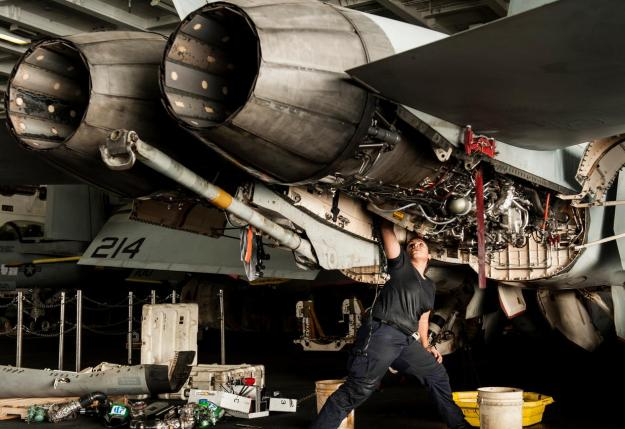 Aviation Machinist's Mate 2nd Class Alexandra Mimbela performs maintenance on an F/A-18F Super Hornet. US Navy Photo