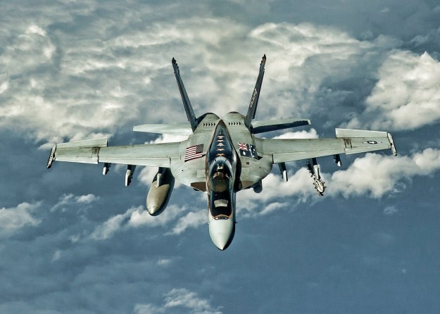 """An F/A-18E Super Hornet assigned to the """"Eagles"""" of Strike Fighter Squadron (VFA) 115 transits the Bismarck Sea in March 2016 en route to Royal Australian Air Force (RAAF) Base Townsville, Queensland, Australia. VFA-115 is conducting bilateral operations with the RAAF as part of Exercise Black Dagger. US Navy photo."""