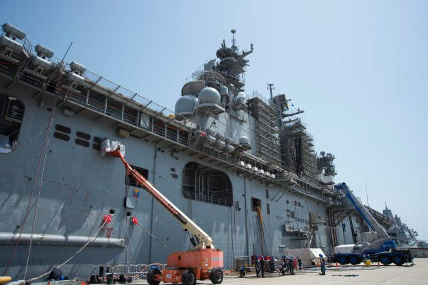 Sailors assigned to amphibious assault ship USS Bonhomme Richard (LHD 6) conduct maintenance during a ship's restricted availability (SRA) period in Sasebo on April 14, 2016. US Navy photo.