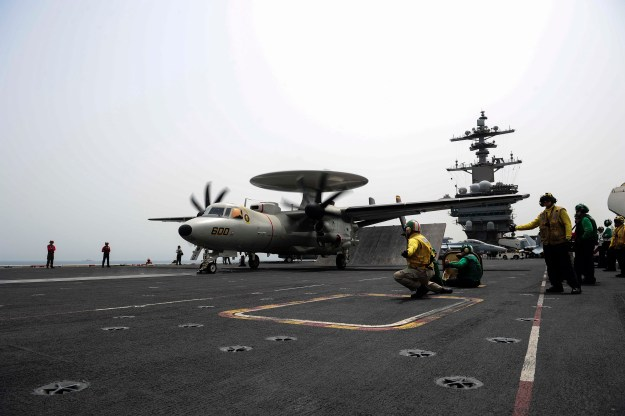 An E-2D Hawkeye, assigned to the Tigertails of the Carrier Airborne Early Warning Squadron (VAW) 125, prepares to launch from the flight deck of the aircraft carrier USS Theodore Roosevelt (CVN 71) on April 28, 2015, while operating in U.S. 5th Fleet area of operations. US Navy photo.