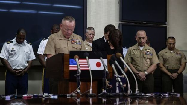 Okinawa Area Coordinator and Commanding General for III Marine Expeditionary Force Lt. Gen. Lawrence Nicholson holds a moment of silence as he announces a 30-day period of unity and mourning for all U.S. military and Status of Forces Agreement personnel on Okinawa, at a press conference on Camp Foster, Okinawa, Japan, May 28, 2016. US Marine Corps photo.