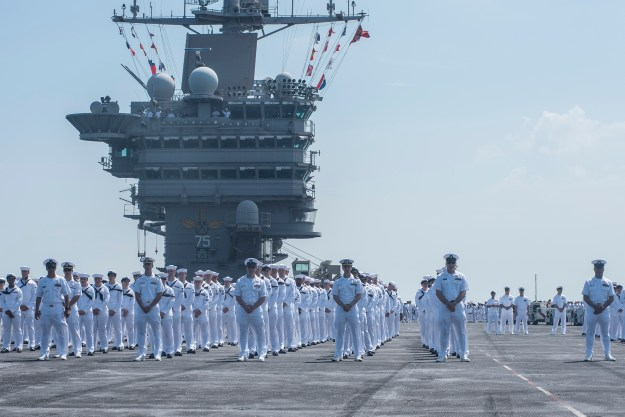 Sailors prepare to man the rails aboard the aircraft carrier USS Harry S. Truman (CVN-75) as it returns to homeport at Naval Station Norfolk, Va. on July 13, 2016. US Navy Photo