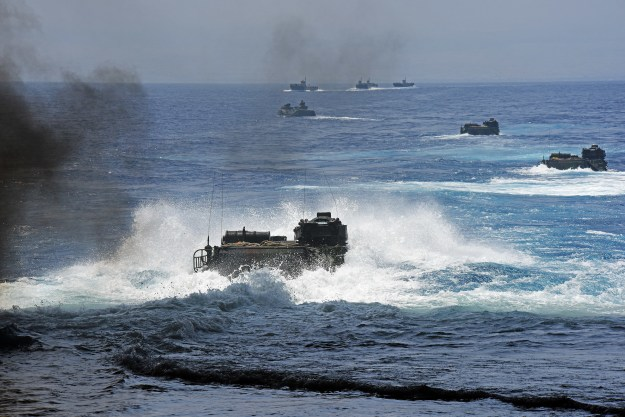 Amphibious assault vehicles depart the well deck of amphibious transport dock ship USS San Diego (LPD 22) while Royal Australian Navy LHD landing craft wait to escort them on July 18, 2016. US Navy photo.