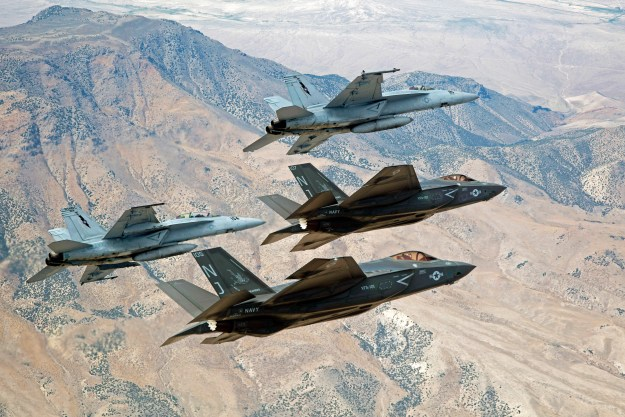 F-35C Lightning IIs, attached to the Grim Reapers of Strike Fighter Squadron (VFA) 101, and an F/A-18E/F Super Hornets attached to the Naval Aviation Warfighter Development Center (NAWDC) fly over Naval Air Station Fallon's (NASF) Range Training Complex on Sept. 3, 2015. US Navy photo.