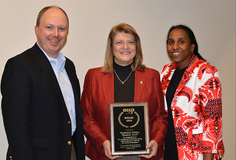 Shown L to R:  Drs. David Rogers and Stephanie Phelps and UTCOP Dean Chisholm-Burns