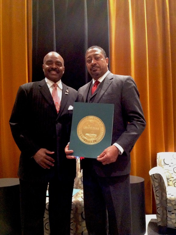 Dr. Kennard Brown, executive vice chancellor and COO of the University of Tennessee Health Science Center, (right), is congratulated by State Rep. G. A. Hardaway, D-Memphis, for receiving the Health Care Education Award from the Council on Workforce Innovation in Nashville.