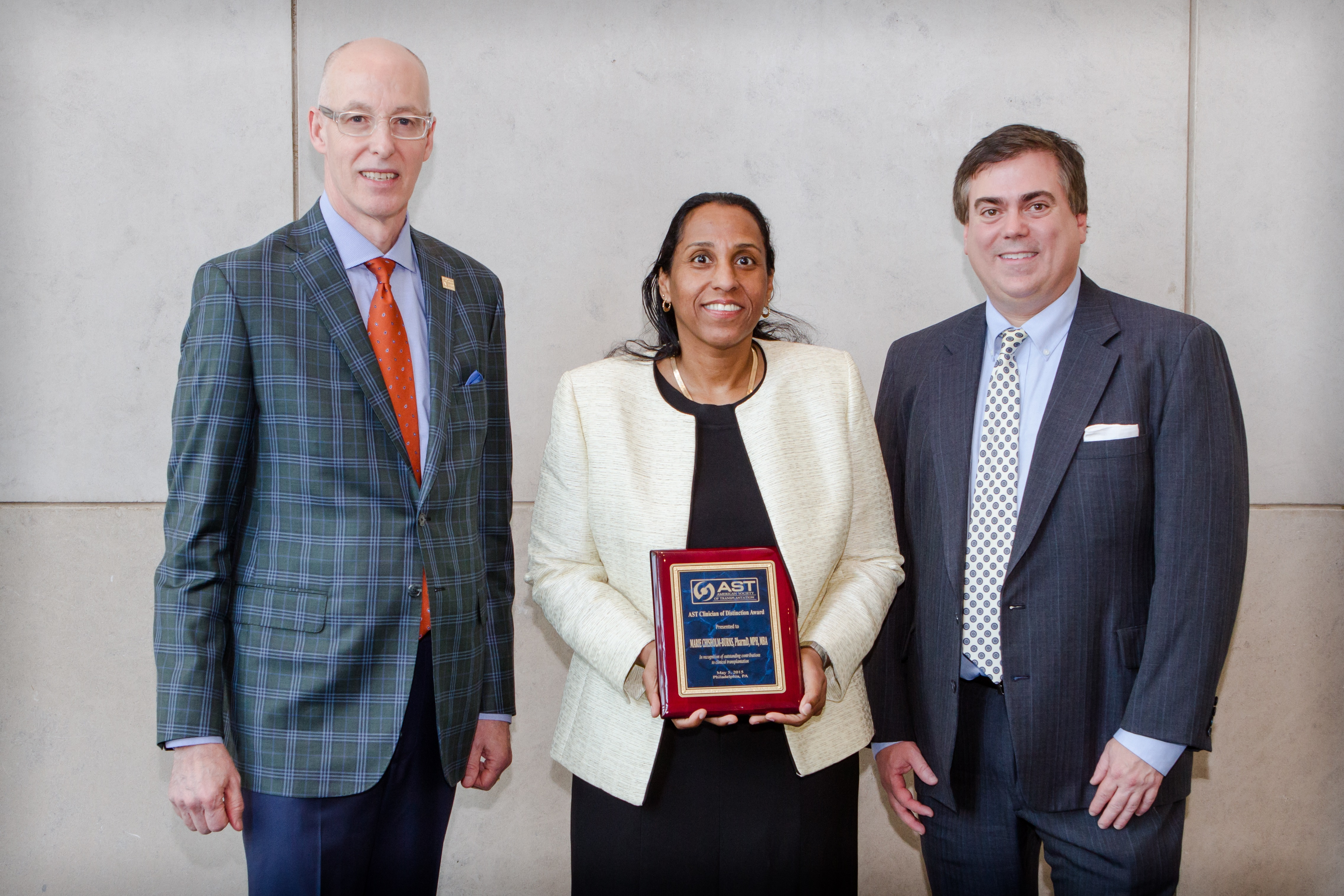 Dr. Marie Chisholm-Burns, dean of the College of Pharmacy at UTHSC, center, received the Clinician of Distinction Award from the American Society of Transplantation (AST). With her are Kenneth Newell, AST immediate past president, and James Allan, AST president.