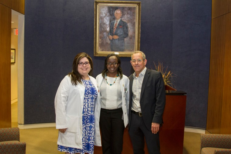 Mercy Kibe, center, is pictured with her mentors, Vanessa Morales-Tirado, MS, PhD, assistant professor of Ophthalmology at UT Health Science Center, and Matthew W. Wilson, MD, FACS, UTHSC professor in the Department of Ophthalmology and director of ocular oncology. Dr. Wilson is also St. Jude Endowed Chair in Pediatric Ophthalmology.